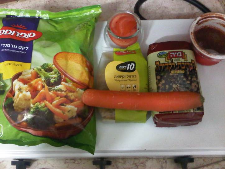 Frozen vegetable mix, dry bulgur and quinoa mix, dry lentil and bean mix, tomato paste, a carrot and half a tomato