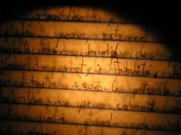 Burning Writing Of An Dark-Illuminated Paper Sheet